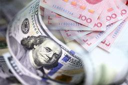 在岸人民币对美元汇率开盘拉升逾200点